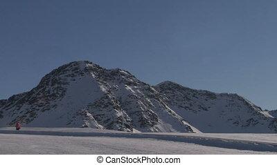 skier 07 - A skier walking in the snow