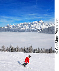 Skier above the clouds