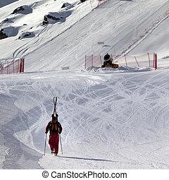Skier ascend on snow ski slope at sun evening - Skier ascend...