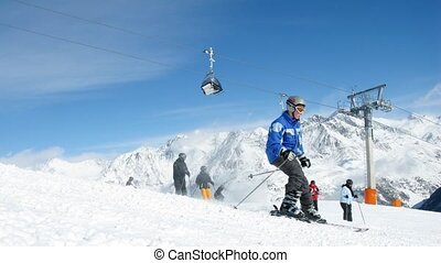 Skier climb down mountain on skis and rise on mountain...