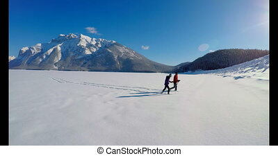 Skier couple walking on snowy landscape 4k - Skier couple...