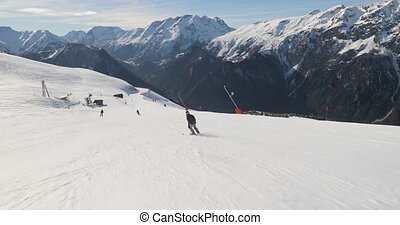 Skier going down the snowy slope, follow shot 60 fps 4k footage