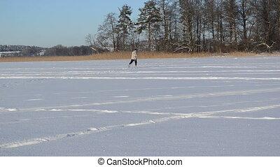 skier frozen lake man