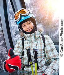 Skier girl on ski lift