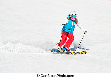 Skier girl while ago slalom curves