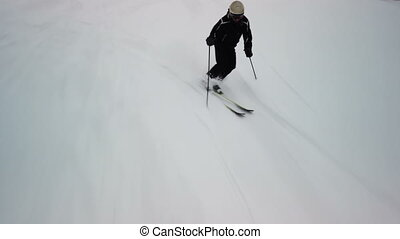 Skier going down the slope. Ski course for the background