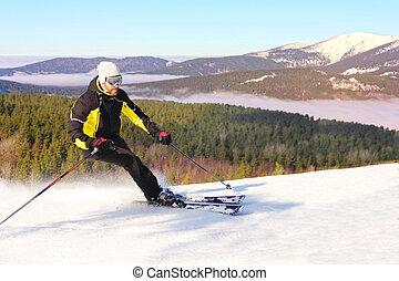 Skier in morning mountains