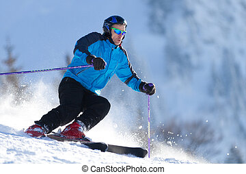 skier is carving down the hill