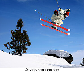 Skier jumping - A young man jumping high at Lake Tahoe ...