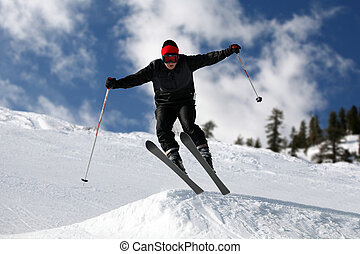 Skier jumping - Skier on a slope against the cloudy sky