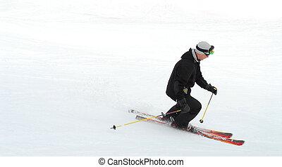 Skier - Man skiing downhill