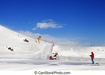 Skier on snow ski slope at sun day. Greater Caucasus,...
