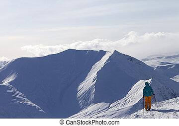 Skier on top of mountain
