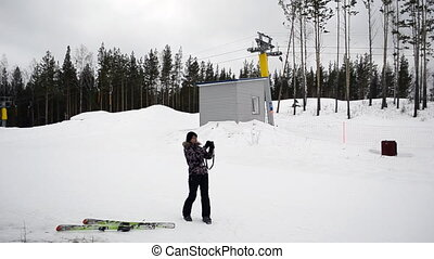 Skier photographs at mountain top