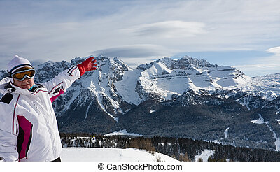 Skier pointing at the slopes of Ski resort Madonna di Campiglio.