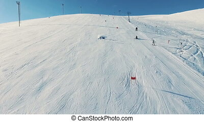 Skier rides dounhill on track.