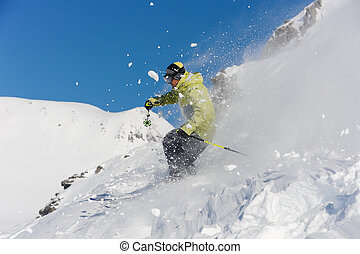 Skier running down the slope in beautiful Gudauri, Georgia -...