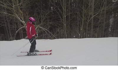 skier skiing on ski slope on winter day in Carpathians...