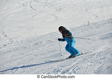 skier - jumping skier at mountain winter snow fresh suny day