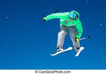 Skier and a blue sky