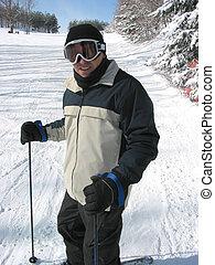 Skier - Happy man enjoying downhill skiing