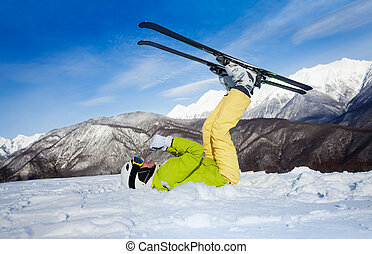 Skier upside-down laying in snow