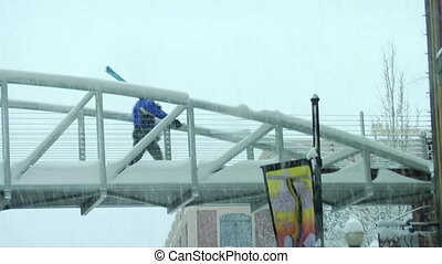 skier walks across the bridge in Park city Utah