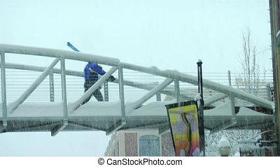 skier walks across the bridge in Park city Utah