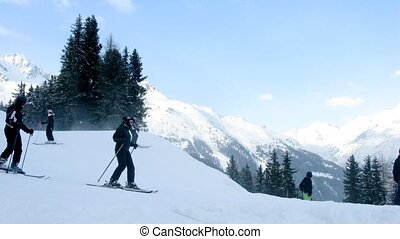 Skiers go on turn and go down from mountain - SOELDEN - FEB...