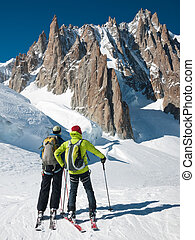 skiers in front of Mont Blanc - Two mountain touring skiers...