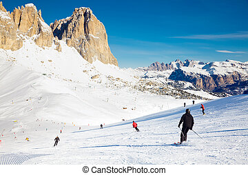 Skiers on a Piste - Skier going down the slope at Val Di ...