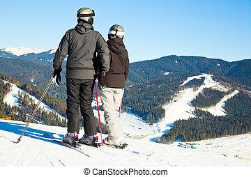 Skiers on a piste