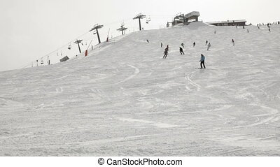 Skiers on a piste