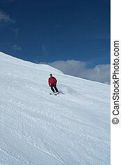 skiers on the descent into the valley