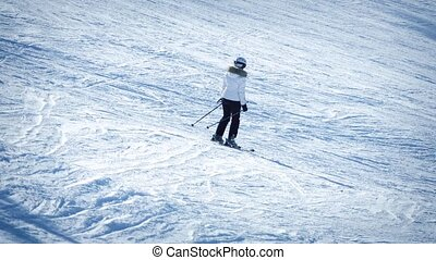 Skiers Passing On Slope - People ski past on mountain slope