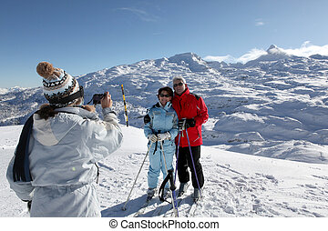 Skiers posing with the mountain landscape