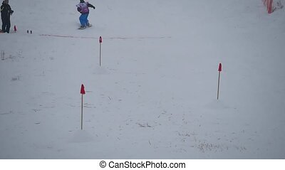 Skiers ride on a mountain slope in snow, skier winter...