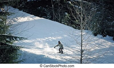 Skiers, Snowmobile And Snowboarders - People ski past on...