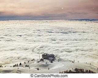 Skiing above fog
