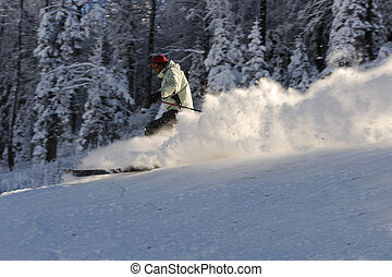 Skiing at ski resort, blured skier in fast motion, extreme sport
