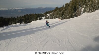 Skiing fast in the French Alps, first person point of view, descent