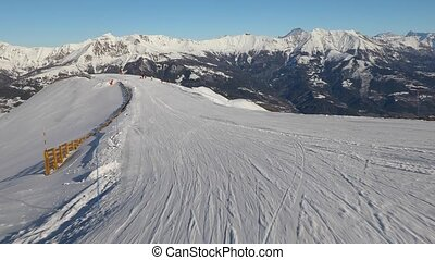 Skiing down a slope - Skiing in the French Alps, first...