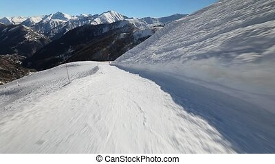Skiing down a slope - Sking in the French Alps