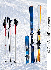 Skiing equipment - Image of skis and sticks in snowdrift on...