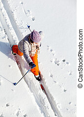 Skiing female - Above angle of middle aged woman skiing...