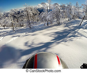 Skiing in fresh snow. POV using action cam on the helmet. ...