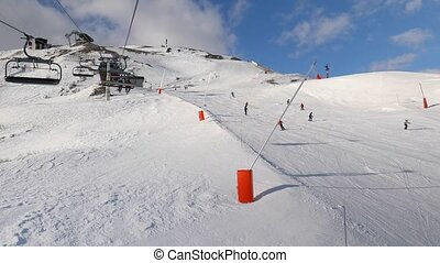 Skiing in the ALps - Using ski lift in the Alps, people...