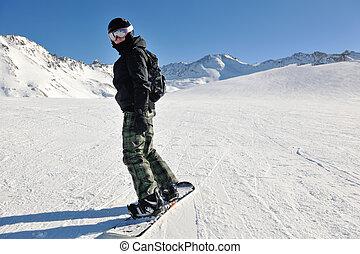 skiing on fresh snow at winter season at beautiful sunny day