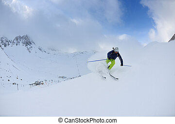 skiing on fresh snow at winter season at beautiful sunny day