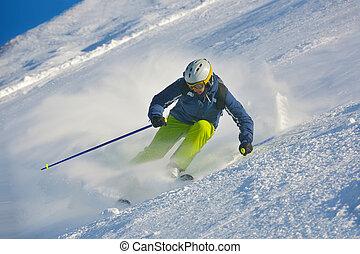 skiing on fresh snow at winter